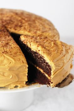 Chocolate Cake with Dulce de Leche Cream Cheese Frosting ~ a moist and fluffy chocolate cake that'll soothe even the most intense chocolate cravings. Topped with a dulce de leche cream cheese frosting, this indulgent cake will wow your guests as well as your taste buds!