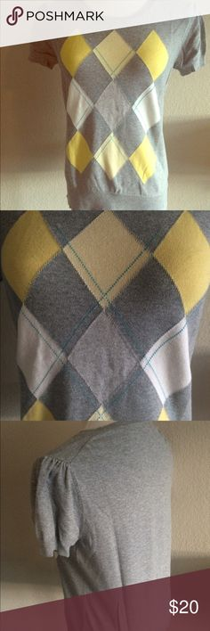 Merona Argyle Cap Sleeve Sweater Grey Yellow Short sleeve argyle sweater from Target in Grey, Yellow and Blue. Sleeves have a bit of a puff detail, which is super cute. Great material, perfect year round, especially for an office. Crew neck. Great length, not too short. Cared for very well and only worn a couple of times. True to size for Merona, which I find to run a bit small generally. Merona Sweaters Crew & Scoop Necks