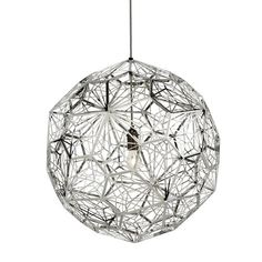 Tom Dixon's Etch Web Pendant casts atmospheric angular shadows. This large, prominent fixture is made through the process of digital photo-acid etching onto stainless steel. Quite the masterpiece!