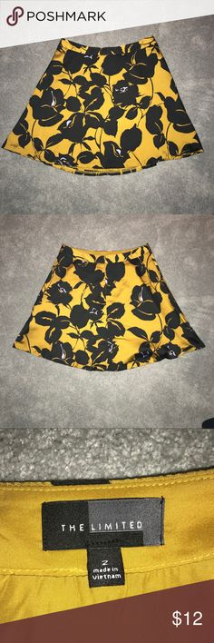 The Limited Floral Skirt Beautiful yellow, black, and purple floral print skirt in size 2 from The Limited! In excellent condition and perfect for work or with a pair of black tights underneath The Limited Skirts