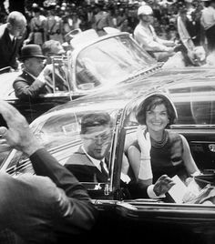 President John F. Kennedy and First Lady Jacqueline Kennedy in a motorcade at the arrival ceremonies for President Muhammad Ayub Khan of Pakistan, 1961