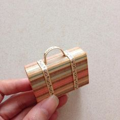 Then glue it in between the 2 strips... And you are done with a mini matchbox suitcase...