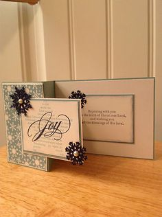 handmade Christmas card ... Z-fold with an overhang panel ... kraft paper and black ink and die cut snowflakes ... elegant look ...luv the calligraphy in the JOY stamp ...