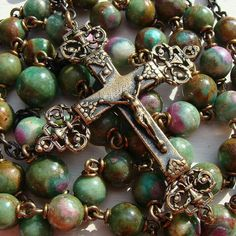 The bronze crucifix has both chalice and filigree details on the arm ends. Hail Mary, Rosary Catholic, Rosary Beads, Fantasy Jewelry, Beads And Wire, Crucifix, Filigree, Blessed, Bronze