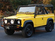 One of my dream cars: Land Rover Defender 90 with a soft top (this is the 1995 model, yellow).