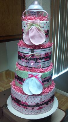 Sweet Baby girl diaper cake is a 70 Pampers swaddlers adorn with all the items that the new Mommy registered for. (Back of Cake)