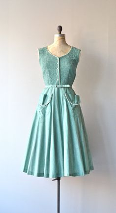 vintage 1950s sea glass green cotton day dress with textural solid ruched bodice, white piping, button front bodice, fitted waist, matching belt,
