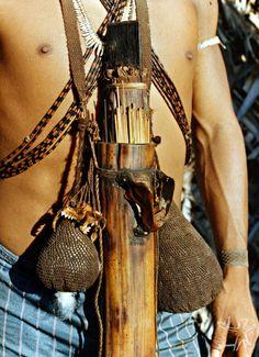 Matis Indian |  Details of his 'Blowpipe' arrows.  Boeiro Creek, Itui River.  Valley of Javari Indigenous Land,  Amazon. Brazil | 1985. (c): Isaac Amorim Filho