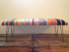 bench upholstered with kilim rug and hairpin legs