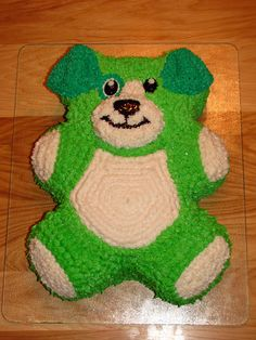 Scout from Leapfrog  My daughter really wanted a Scout cake for her birthday.  I used the Wilton teddy bear cake pan and just modified the ears.  She loved it!