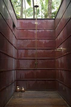 outdoor shower with brass fixtures by studio mumbai architects.