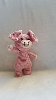 The pig on the photo is made from Catania yarn on hookzise 2.5 and is approximately 20cm high.