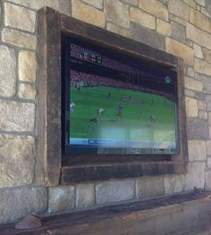 DIY TV Frame - love the way it's built into the stone!