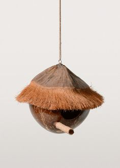 Why throw away old coconut shells when they can be turned into funky tropics-inspired birdhouses? The thatched roof is crafted from coconut fibre while the perch is wrapped in seagrass. A cozy, sustainable place for birds to rest.
