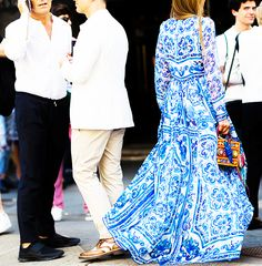 Anna Dello Russo wears a blue and white printed maxi dress by Dolce & Gabbana with an embellished box bag