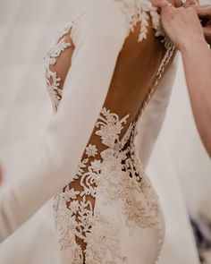 Barcelona Bridal Fashion Week Backstage at Pronovias Model wearing a beautifully embroidered wedding gown with illusion lace details and fitted long sleeves // Before we rev. Dream Wedding Dresses, Bridal Dresses, Wedding Gowns, Revealing Wedding Dresses, Backless Wedding, Lace Weddings, Wedding Beach, Summer Weddings, Mermaid Dresses