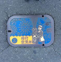 Arm hold fireworks air bulb manhole. Place: Toyohashi city, Aichi, Japan.