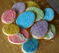 My cookies: Easter Egg cookies.   No Fail Sugar Cookies.  Chocopan fondant textured with various pattern presses, rollers, molds.  Cookies colored with pearl dusts.  I like Chocopan because you can roll it thinner and it tastes so much better than MMF.