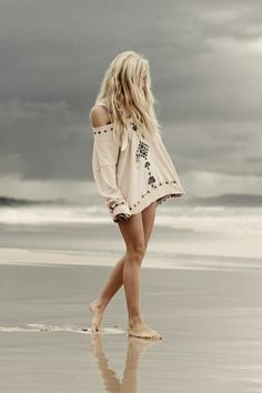 Walking in the sand. Surfer girl style