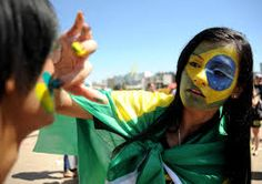 History- This picture shows Independence day in Brazil, so these girls are painting their faces to look like the flag of Brazil to support their country. On September 7, 1822 Brazil was declared an independent country, and every September 9th they celebrate together for their independence.