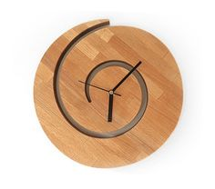 Spiral Sun Wooden Wall Clock, Solid Wood Sun Clock This solid wooden clock in the shape of a spiral sun will most definately be special accessory to your living room or kitchen. This clock is...