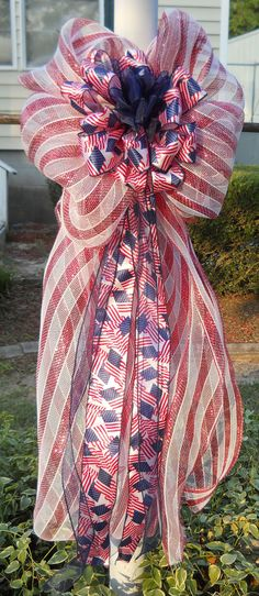 Four Patriotic Mesh Outdoor Post Lamp Bows (Custom for Larry Coleman). $100.00, via Etsy.