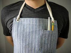 """Gingham cotton and denim aprons - easily converted to """"half aprons"""". Designed for men, but work for women. Cool Aprons, Aprons For Men, Sewing Aprons, Denim Aprons, Restaurant Uniforms, Work Uniforms, Apron Designs, Half Apron, New Print"""
