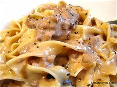 Crockpot Beef Stroganoff  1-2 lbs cube steak, cut into one-inch pieces  2 cans condensed golden mushroom soup (no substitutes!)  1 cup chopped onion  1 Tb Worcestershire 1 14 oz can beef broth, salt & pepper 4 oz cream cheese, room temp  1/2 c. sour cream  In the crockpot, combine the meat, soup, onion, Worcestershire sauce, salt & pepper and beef broth. Cook on low for 5-6 hours 3. Stir in cream cheese and sour cream about half hour b/f serving. Serve over Egg Noodles.