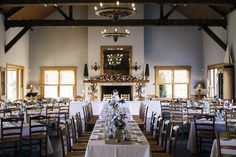 Reception styling at Centennial Vineyards, near Bowral, New South Wales Southern Highlands. Exposed beams, fireplace, candles, floral designs and table settings.