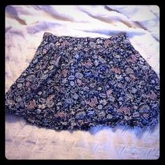 I just added this to my closet on Poshmark: Blue and pastels patterned skirt. Price: $8 Size: L