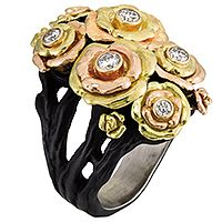 Bee Cluster ring in oxidized cobalt chrome and 18k yellow, rose, and white gold with diamonds; price on request; Sarah Graham Metalsmithing, La Quinta, Calif.; 800-670-0917; sarahgraham.com