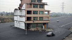 An elderly Chinese couple who refused to move out of their apartment building to make way for a new development has found themselves surrounded by a huge freeway.  It's not uncommon for tenants to refuse to budge for developers since laws in China made it harder for builders to simply force stubborn homeowners out.