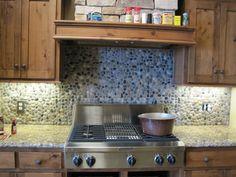 Granite Counter With Tumbled Edge And Riverwashed Pebbles Backsplash. Visit  Globalgranite.com For Your