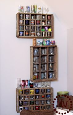 Coke crates on the wall for shot glass collection display