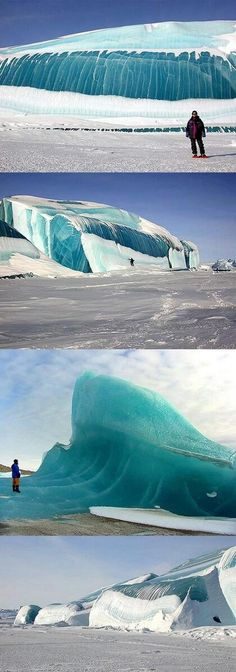 The 'frozen wave': Stunning 50ft blue ice monolith captured in the Antarctic