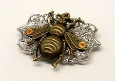 Steampunk bumble bee with gears brooch pin. Steampunk by slotzkin