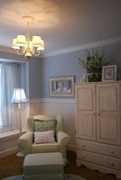 Nursery--love the rocking chair tucked in the corner.