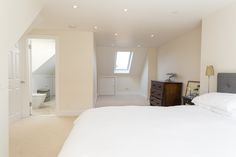 Loft conversion bedroom with view to ensuite bathroom and dressing area