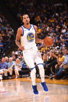 Shaun Livingston of the Golden State Warriors handles the ball against the Toronto Raptors on October 25 2017 at ORACLE Arena in Oakland California...