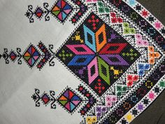 Embroidery detail from table cloth. Olga Malanchuk made this in 1957 from a Nasha Chata magazine pattern.