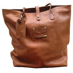 """Madame Rose is fancy yet casual. Big enough to hold everything, made of eco vintage mid-brown leather. The bag closes with a knob button"""