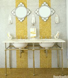 Glass tiles from Waterworks line the walls and floor in the guest bathroom of this California country home by designer Jay Jeffers. The amber stripes break up the space and add a note of whimsy. Click through for more of the best bathroom colors and paint color schemes for bathrooms.