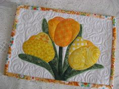 Looking for your next project? You're going to love Spring Tulips Mug Rug by designer 2strings. - via @Craftsy