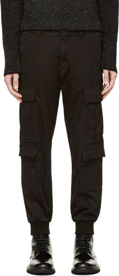 Relaxed-fit cargo pants in black. Eight-pocket styling. Ribbed knit ankle cuffs. Tonal stitching. Zip fly.
