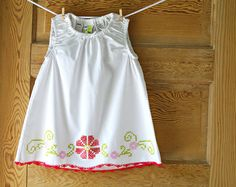 Pillowcase dress.  Love that it doesn't have ribbon like all the rest.  Vintage pillowcases are my fav too!