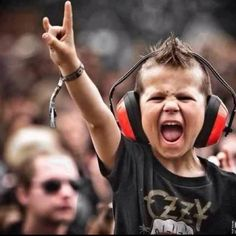 Teaching our youth to #RocknRoll early on! | little boy | mohawk | concert | kid | metal | rock