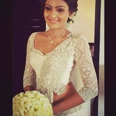 Sri Lankan bride in classy gold jewellery.