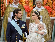 Prince Carl Philip looked lovingly at Princess Sofia, who held their son, Prince Alexander, during the ceremony 9 Sept 2016
