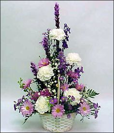 Lavender For Love Soft lavender and purple flowers are designed in this fresh white washed basket, featuring purple Liatris, lavender Larkspur, purple Monte Casino and accented with lacy white Carnations.