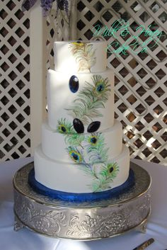 Peacock round wedding cake with handpainted feathers and edible jewels